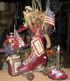 Primitive Patriotic Vignette...love the bear in the old roller skate!