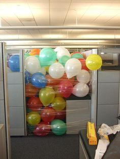 Make any co-worker feel special with a personalized balloon pit!