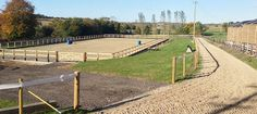 Outdoor riding arena surrounded by sand gallops - Castle Piece Stables