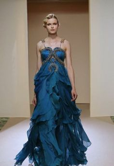 Dany Atrache.    I love the soft floral like ruffles of this dress!!!