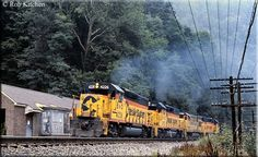 An eastbound freight led by B&O GP40-2 #4226 climbs the grade at Cotton Hill, West Virginia during August of 1982.