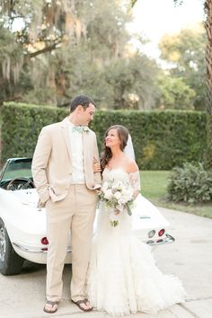 Bride and groom with vintage Corvette  | Amy and Mikes Lakeside wedding | www.AmalieOrrangePhotography.com