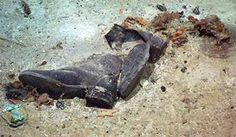 Titanic artifacts - a sad reminder that she isn't just a glorious shipwreck, but a graveyard. Leather doesn't decay, but the body did.""