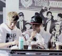 Kai saves Tao from a bug just by sweeping it with a tissue. Jongin saves the day♡ haha (gif)