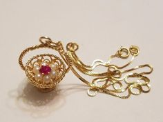 14k yellow gold Ruby & Pearls in a Basket pendant Necklace