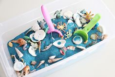 "A DIY Summer Sensory Bin. Little ones will love to explore their senses through play using these ""easy to make"" summer sensory bins. The ocean theme is sure to entice learning and enrich children's play time. All you need for the cutest summer activity."