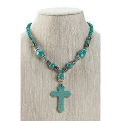 Gorgeous! This incredible statement necklace has a variety of turquoise-color stones mixed with decorative silver metal beads. The centerpiece is a magnificent