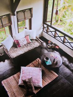 mix of traditional balinese furniture, backed with vintage global textiles sourced from around the world