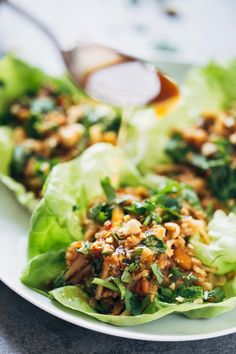 Peanut Chicken Lettuce Wraps with a Ginger Garlic sauce - made from scratch with chicken, peanuts, rice noodles, and extra sauce for serving! #easyrecipe #healthy #cleaneating #chicken | pinchofyum.com