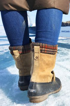 The Saltwater Misty Plaid Duck Boot features matte rubber and printed canvas materials to protect against the elements.