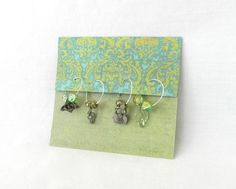 DIY Wine Glass Charms  - great way to package them on cute paper (which I know you have)