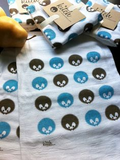 """Adorable, hand screen printed Hedgehog dish towel. Perfect for cute-ing up your kitchen! 100% Cotton, machine washable flour sack dish towel measures approx 30""""x30"""" - Print measures approx. 7""""x10.5"""" - and is super absorbant and lint free. Print is in light blue and dark taupe on one bright white towel. Comes packaged in very sweet natural cardstock ring with matching graphic on the front - Makes a PERFECT housewarming or hostess gift!$8"""