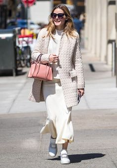 Olivia Palermo just paired her white sneakers with an unexpected outfit. See the look, and find out how to re-create it here.