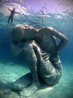 This stunning 18-feet-tall, 60-ton underwater sculpture of Bahamian girl carrying the weight of the ocean in Nassau, Bahamas.