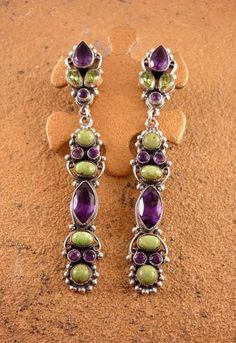 Earrings set with Amethyst, Peridot, and Gaspeite by Leo Feeney