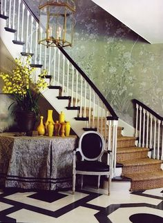 Mary McDonald pulled out all the stops in this dramatic foyer featuring hand-painted deGournay wallpaper and a geometric painted floor.