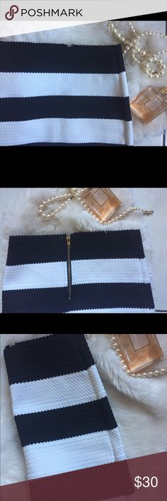 Black and white bandage mini skirt Black and white bandage mini skirt, new but no tags tried on but not worn it's been hiding in my closet doesn't fit me Size : Small see pictures flawless!it has gold zipper in the back. Skirts Mini