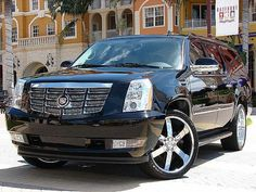 Cadillac Escalade (black). The 'dream cars' of most people are convertibles, however I've always had a thing for Escalades and Suburbans.