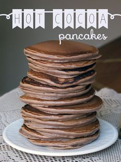 Quick and easy from-scratch recipe for fluffy and hot-chocolaty pancakes. Guaranteed to be a hit at the breakfast table, these pancakes are ready in twenty minutes or less. Next time use a richer flavored hot cocoa mix. What's For Breakfast, Breakfast Pancakes, Pancakes And Waffles, Breakfast Recipes, Dessert Recipes, Mexican Breakfast, Crepe Recipes, Breakfast Sandwiches, Breakfast Bowls