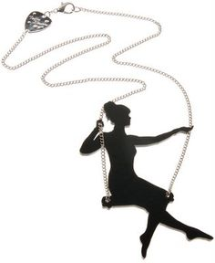 swinging girl (probably lazer cut as opposed to shrink plastic)