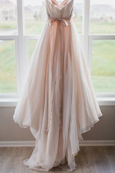 Pink wedding dress. All brides want to find themselves having the perfect wedding, but for this they need the best bridal gown, with the bridesmaid's outfits enhancing the brides-to-be dress. Here are a few ideas on wedding dresses.
