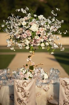 centerpiece idea: turn a branch + dried flowers into a flowering tree, place into a glass jar with stones for a base