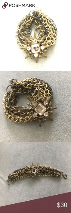 Nordstrom Bracelet Beautiful multi-chain and multi-color bracelet : toggle closure : has gold, gunmetal, and bronze with clear stones in star shaped : don't remember Brand but it was bought at Nordstrom : good condition but a bit of tarnishing. Nordstrom Jewelry Bracelets