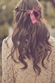 Waterfall braid and pink bow.