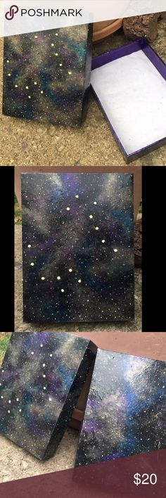 """Painted galaxy w Dippers constellation decor box Hand made by artists at Electric Honey Bee Studio ❤️☺️✨ to see more go check out electrichoneybeestudio.bigcartel.com !!! This is a hand painted (with nail polish and acrylic paints ) repurposed or recycled hard cardboard gift box. It is painted to look like our galaxy with the big and little Dippers or """" Big Bear and Little Bear"""". The interior is metallic purple and padded and lined with just a touch of glitter sparkle in the threading…"""