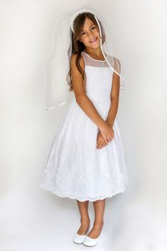 Your communion cutie or flower girl will love this sleeveless satin dress, featuring a pearl-beaded illusion yoke, a pleated organza cummerbund, and a corded lace hem. By Us Angels Polyester Back zipper; Organza Dress, Satin Dresses, Girls Communion Dresses, Necklines For Dresses, Davids Bridal, Wedding Gowns, White Dress, Flower Girl Dresses, Illusion