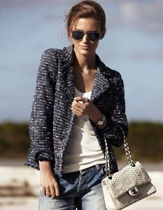A navy tweed jacket and blue boyfriend jeans are perfect for both running errands and a night out.  Shop this look for $321:  http://lookastic.com/women/looks/navy-jacket-and-white-tank-and-white-satchel-bag-and-blue-boyfriend-jeans/3917  — Navy Tweed Jacket  — White Tank  — White Snake Leather Satchel Bag  — Blue Boyfriend Jeans