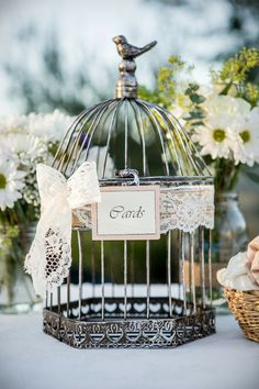 A shabby chic birdcage to place all the wedding cards! | Evan Chung Photography