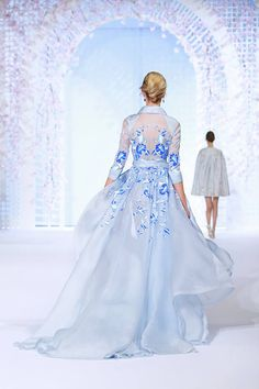 Mint blue organza kimono robe with graphic, floral hand painting. Discover more at www.ralphandrusso.com