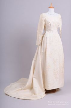 Designed in the 60's, by Bianchi of Boston (aka House of Bianchi), this amazing vintage wedding gown is done in a heavy weighted silk in a French vanilla ton...