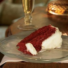 Red Raspberry Velvet Cake | Culinary historians believe red velvet cake recipes originated in New York City in the 1950s at Oscar's at the Waldorf-Astoria Hotel. Regardless of its origins, the dessert recipe pairs red-tinted cake with creamy white frosting--a fitting combination for the holidays.