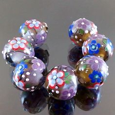 PIKALDA=handmade lampwork 7 glass beads flower bloom=LAVENDER & GREEN GARDEN=SRA