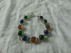 carole sousa bracelet green blue gold frosted glass cabs