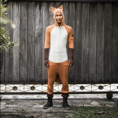 FOX ONESIE Blamo Adventurewear celebrates your inner creature. Our Fantastic Mr. Fox Onesie for Adults is knit in our workshop using a hand drawn knitting machine, and comes with three pockets and button front. Our animal suits are made in small batches and are super comfy and stretchy.