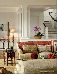 Interior by Alexa Hampton - love the moldings, the staircase in the background and the general calm feel of the room.