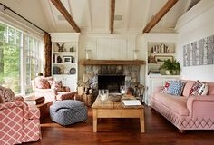 Check out the nailhead trim design on the sofa. I love this room, but to better suit my style, I would add a huge area rug - patterned or plain.