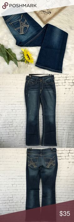"""Ariat Turquoise Bootcut jeans 27S These have been worn once or twice. No condition issues at all. Inseam 30"""". 8.5"""" rise. Waist laying flat measures 14.5"""". Turquoise is the modern go-to jean that flatters feminine curves.  •Mid-rise •Contoured, no gap waist band •Premium, ring-spun, stretch denim •Boot cut leg opening •Medium wash •No-rub comfort inseams •Anchored belt loops •Hand sanding for premium styling Ariat Jeans Boot Cut"""