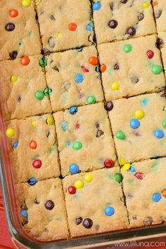 "Simple and delicious Cake Mix Cookie Bars - a great ""go-to"" dessert recipe. { lilluna.com } Soft bars made from yellow cake mix, vanilla pudding, mini m&m's, and chocolate chips!"