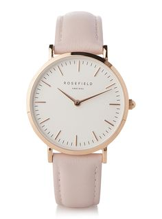 Rosefield collection at Simons: designs inspired by Amsterdam and New York City   A delicate watch with a classic, sophisticated design inspired by Manhattan's elite   Durable Japanese quartz movement   33 mm gold-plated stainless steel case, resistant to water contact (3 ATM)   Adjustable 14.5 to 19.5 mm genuine leather band with tongue buckle