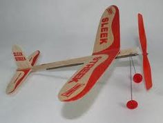 Thin pressed balsa wood Airplanes with propellers wound by a rubberband. Cheap and fun on a kids allowance.