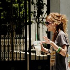 Mary-Kate Olsen. Laughing. Street Style. Boho. Starbucks. Love this loose hairstyle