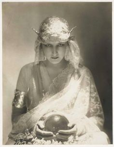 Look into my eyes and I will tell you your trick fortune. Photo by Adolf de Meyer for Vogue, 1921