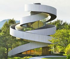 Hiroshi Nakamura's Ribbon Chapel in Hiroshima orients two asymmetrical winding pathways that connect at a rooftop apex.
