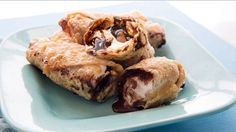 Spring roll wrappers are filled with chocolate, graham crackers and marshmallows, then fried until crispy. A simple s'mores-inspired dessert - and no campfire needed!