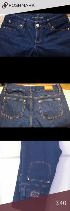 Denim Jeans Michael Kors Dark Denim Jeans with gold stitching very nice pairs of jeans. No rips or tear. There is a faded area on the tip of the jeans at the bottom, the last photo above provides details, can't tell otherwise these jeans looks brand new. All reasonable offers accepted KORS Michael Kors Jeans Straight Leg