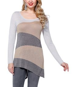 647dbacfbb5b This flattering long sleeve plus size top features an asymmetrical gem cut  with the long end falling at the upper thigh.